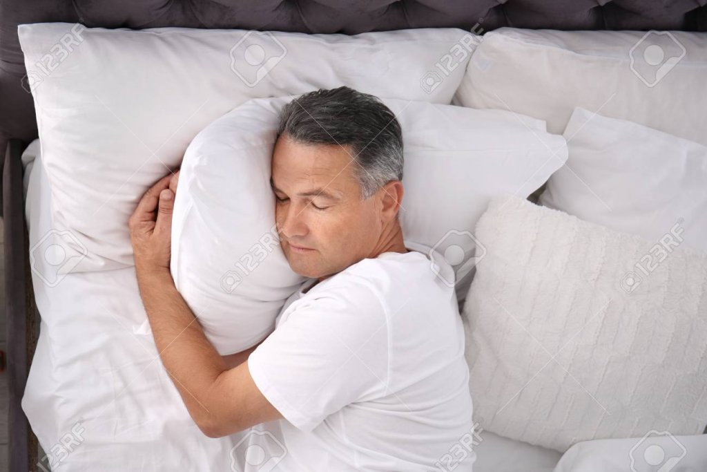 106690672-man-sleeping-on-comfortable-pillow-in-bed-at-home-top-view.jpg