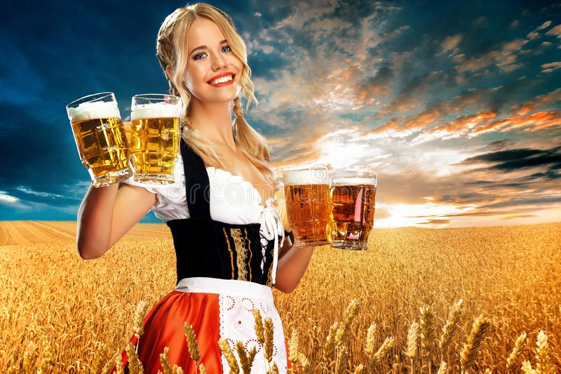 half-length-portrait-young-sexy-blonde-big-breast-wearing-black-dirndl-white-blouse-holding-be...jpg