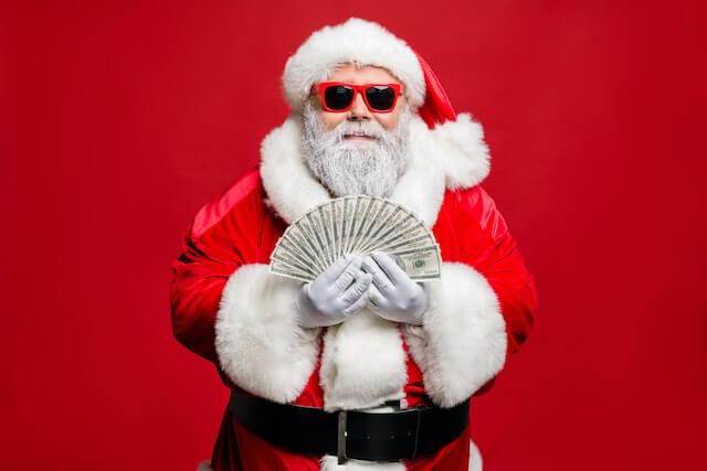 santa-claus-holding-cash.jpg