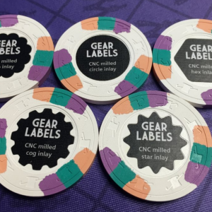 Chris Gear unveils new tech - milled shaped labels!!! - photo by inca 911